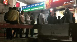 Crowds lined up outside ATMs across the country on Tuesday night