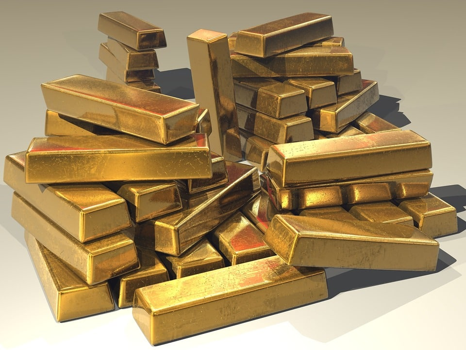 Gold prices drops to nearly 8-month lows