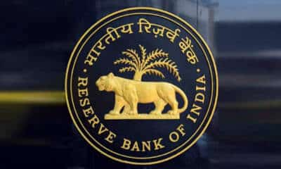 Markets retreat from record highs as RBI trims growth forecast; banks, RIL top drags